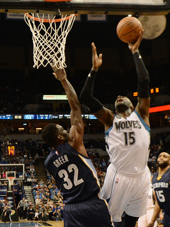 . Minnesota Timberwolves forward Shabazz Muhammad scores two over Memphis Grizzlies forward Jeff Green in the second half at the Target Center on Saturday, January 23, 2016. (Pioneer Press: John Autey)