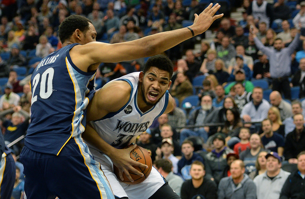 . Minnesota Timberwolves center Karl-Anthony Towns works the paint against Memphis Grizzlies center Ryan Hollins in the fourth quarter at the Target Center on Saturday, January 23, 2016. The Timberwolves beat the Memphis Grizzlies, 106-101. (Pioneer Press: John Autey)