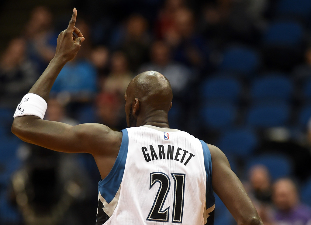 . Minnesota Timberwolves forward Kevin Garnett points to the sky after nailing two from the perimeter against the Memphis Grizzlies in the first half at the Target Center on Saturday, January 23, 2016. (Pioneer Press: John Autey)