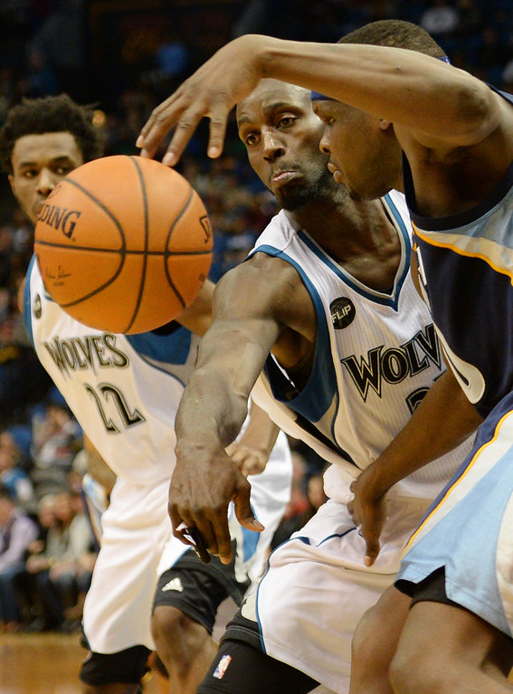 . Memphis Grizzlies forward Zach Randolph has the ball knocked out of his hands by Minnesota Timberwolves forward Kevin Garnett in the first half at the Target Center on Saturday, January 23, 2016. (Pioneer Press: John Autey)