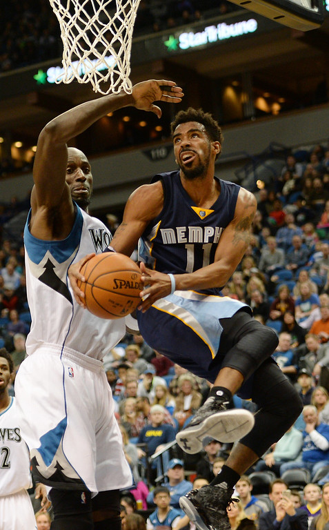 . Minnesota Timberwolves forward Kevin Garnett tries to stop Memphis Grizzlies guard Mike Conley from the lay up in the first half at the Target Center on Saturday, January 23, 2016. (Pioneer Press: John Autey)