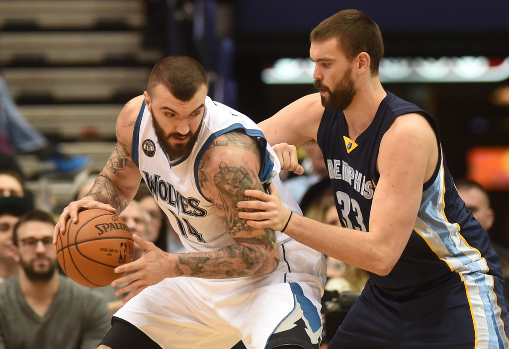 . Minnesota Timberwolves center Nikola Pekovic works in the paint against Memphis Grizzlies center Marc Gasol in the first half at the Target Center on Saturday, January 23, 2016. (Pioneer Press: John Autey)