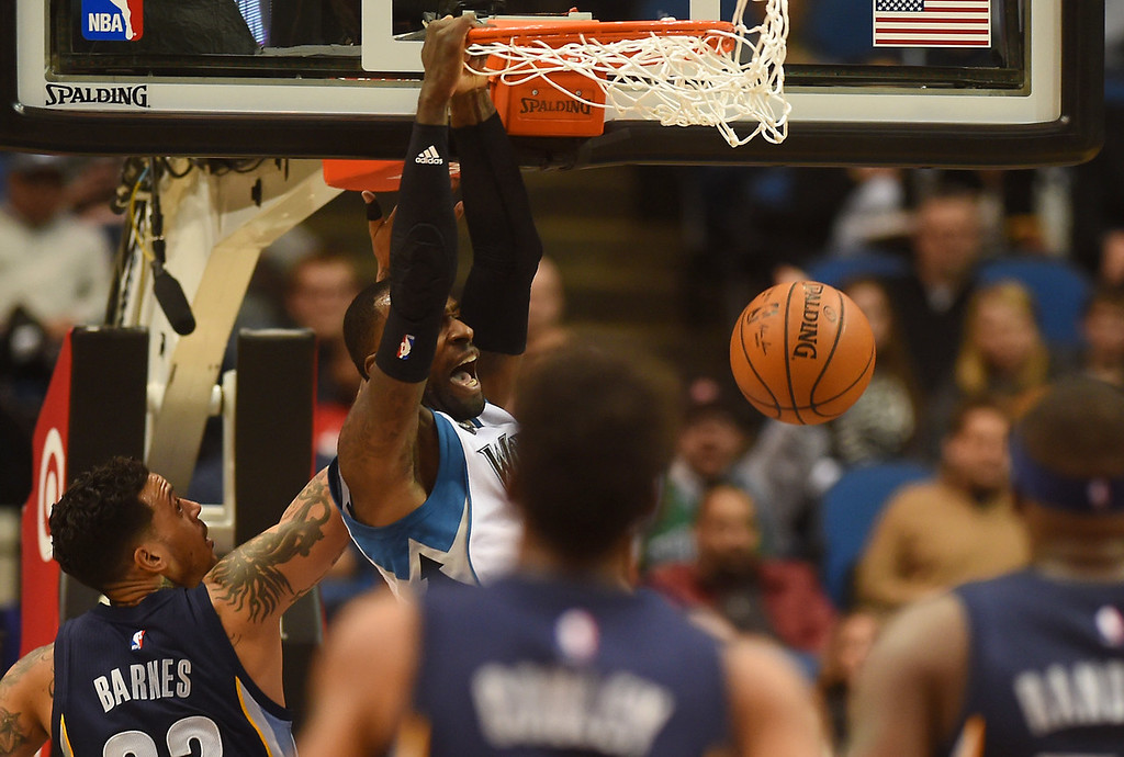 . Minnesota Timberwolves forward Shabazz Muhammad slams home the ball against the Memphis Grizzlies in the first half at the Target Center on Saturday, January 23, 2016. (Pioneer Press: John Autey)