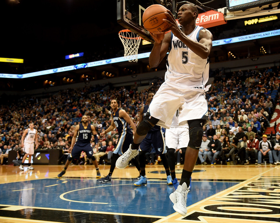 . Minnesota Timberwolves center Gorgui Dieng saves the possession and gets the ball to guard Ricky Rubio as the Wolves play the Memphis Grizzlies in the fourth quarter at the Target Center on Saturday, January 23, 2016. The Timberwolves beat the Memphis Grizzlies, 106-101. (Pioneer Press: John Autey)
