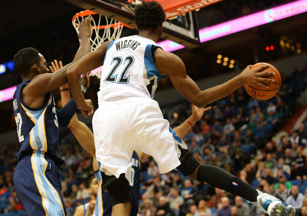 . Minnesota Timberwolves guard Andrew Wiggins makes a pass from under the basket against the Memphis Grizzlies in the fourth quarter at the Target Center on Saturday, January 23, 2016. The Timberwolves beat the Memphis Grizzlies, 106-101. (Pioneer Press: John Autey)