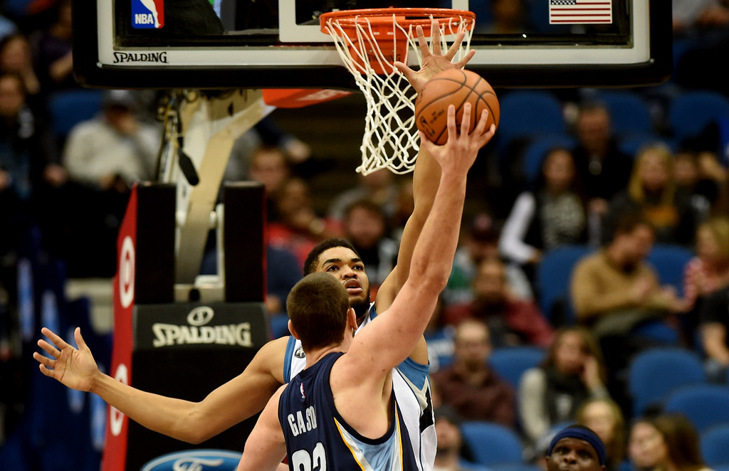 . Minnesota Timberwolves center Karl-Anthony Towns tries to stop a Memphis Grizzlies center Marc Gasol hook shot in the third quarter at the Target Center on Saturday, January 23, 2016. The Timberwolves beat the Memphis Grizzlies, 106-101. (Pioneer Press: John Autey)