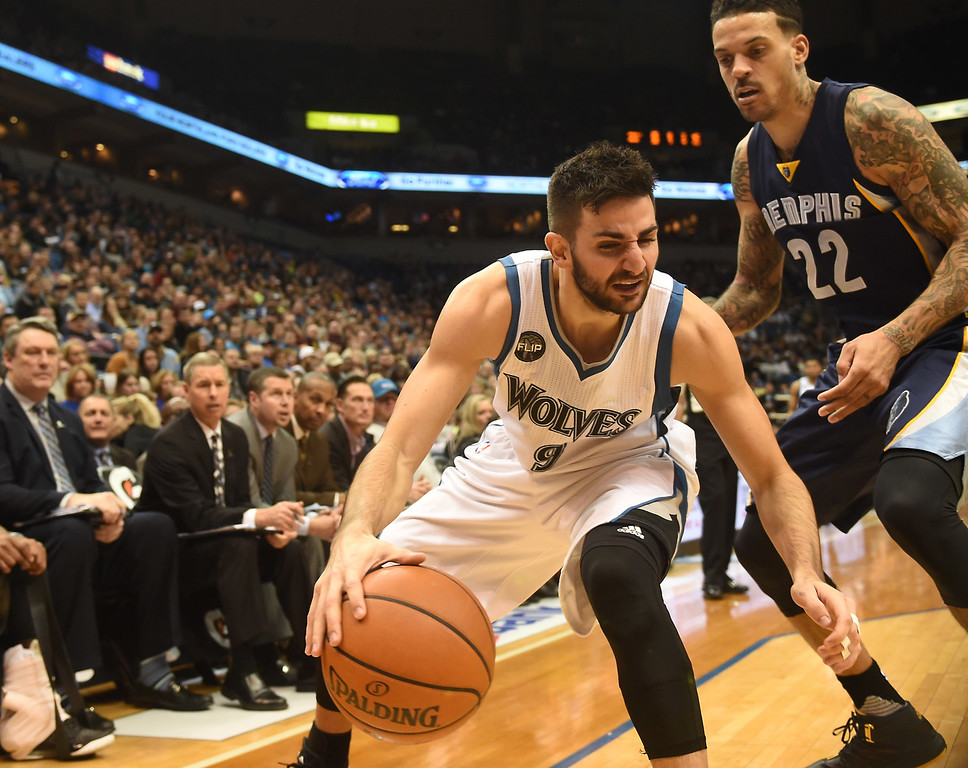 . Minnesota Timberwolves guard Ricky Rubio tries to find an alley as he is defended by Memphis Grizzlies forward Matt Barnes in the fourth quarter at the Target Center on Saturday, January 23, 2016. The Timberwolves beat the Memphis Grizzlies, 106-101. (Pioneer Press: John Autey)