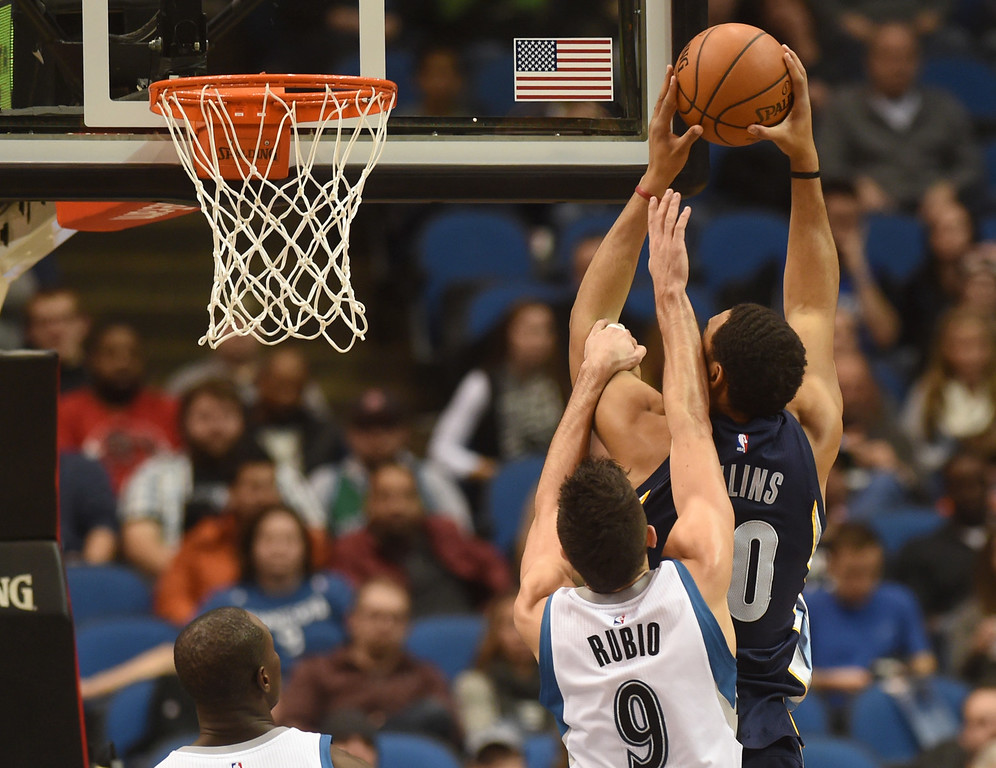 . Minnesota Timberwolves guard Ricky Rubio fouls Memphis Grizzlies center Ryan Hollins to stop the bucket in the third quarter at the Target Center on Saturday, January 23, 2016. The Timberwolves beat the Memphis Grizzlies, 106-101. (Pioneer Press: John Autey)