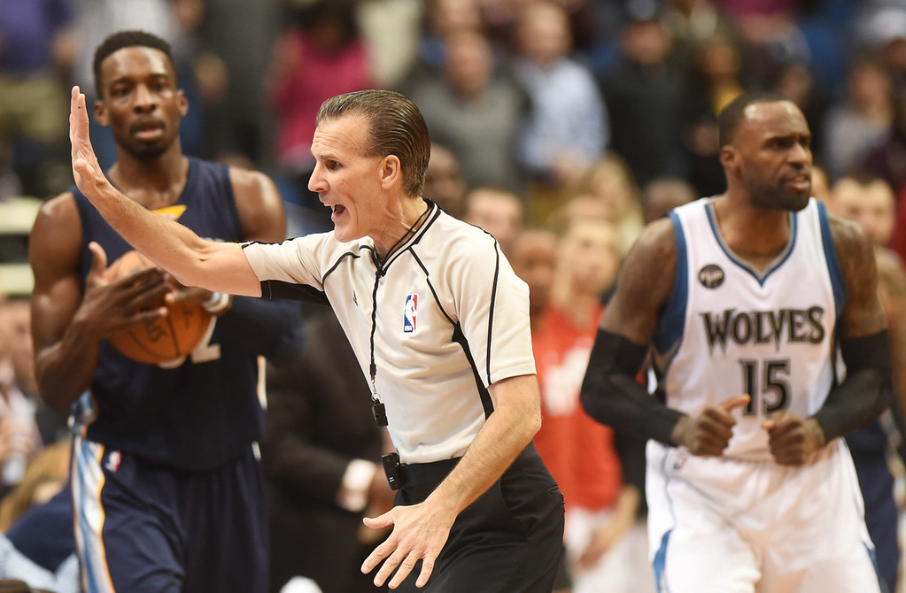 . Referee Ken Mauer calls a five second in bound violation against Memphis Grizzlies forward Jeff Green, left, as Minnesota Timberwolves forward Shabazz Muhammad, right, celebrates in the fourth quarter at the Target Center on Saturday, January 23, 2016. The Timberwolves beat the Memphis Grizzlies, 106-101. (Pioneer Press: John Autey)