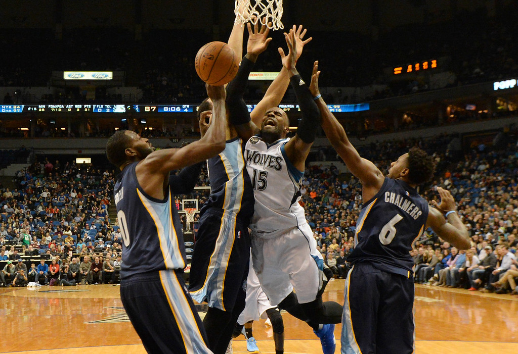 . Minnesota Timberwolves forward Shabazz Muhammad gets fouled by Memphis Grizzlies center Ryan Hollins as he goes up for a basket in the second half at the Target Center on Saturday, January 23, 2016. (Pioneer Press: John Autey)