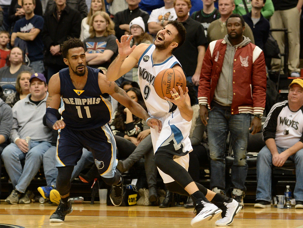 . Minnesota Timberwolves guard Ricky Rubio gets a hand to the groin from Memphis Grizzlies guard Mike Conley as he drives to the basket in the fourth quarter at the Target Center on Saturday, January 23, 2016. The Timberwolves beat the Memphis Grizzlies, 106-101. (Pioneer Press: John Autey)