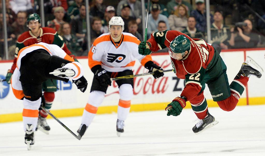 . Minnesota Wild right wing Nino Niederreiter, right, and Philadelphia Flyers defenseman Radko Gudas collide near the blue line in the second period at Xcel Energy Center on Thursday, January 7, 2015. (Pioneer Press: John Autey)