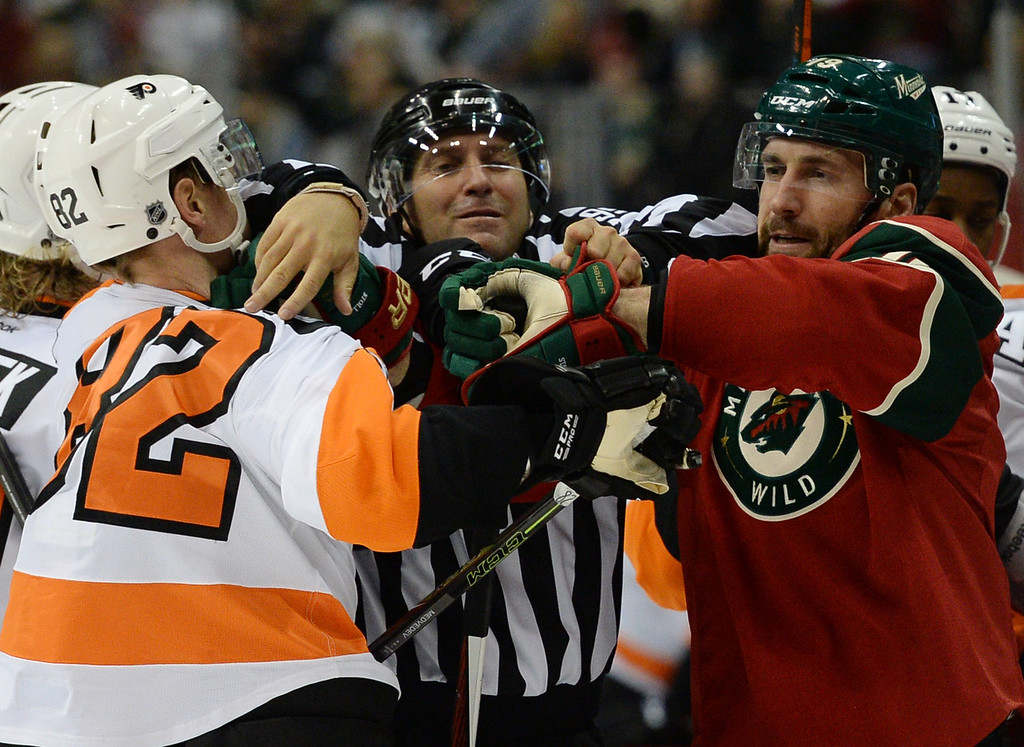 . linesman Jonny Murray tries to keep Philadelphia Flyers defenseman Evgeny Medvedev, left, and Minnesota Wild center Jarret Stoll from coming to blows in the second period at Xcel Energy Center on Thursday, January 7, 2015. (Pioneer Press: John Autey)