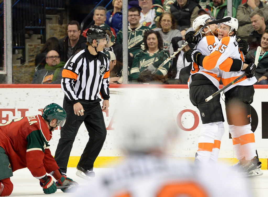 . Philadelphia Flyers defenseman Michael Del Zotto, facing, celebrates his overtime goal against the Minnesota Wild with right wing Jakub Voracek at Xcel Energy Center on Thursday, January 7, 2015. The Philadelphia Flyers beat the Wild, 4-3, in overtime. (Pioneer Press: John Autey)