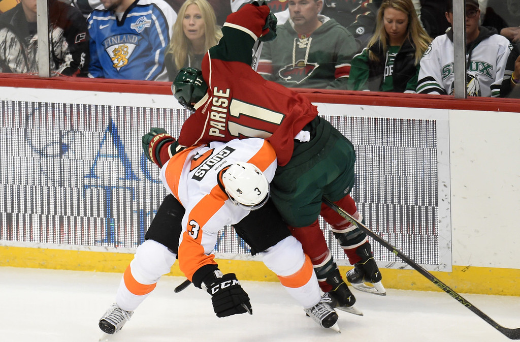 . Minnesota Wild left wing Zach Parise gets checked off the puck by Philadelphia Flyers defenseman Radko Gudas in the first period at Xcel Energy Center on Thursday, January 7, 2015. (Pioneer Press: John Autey)