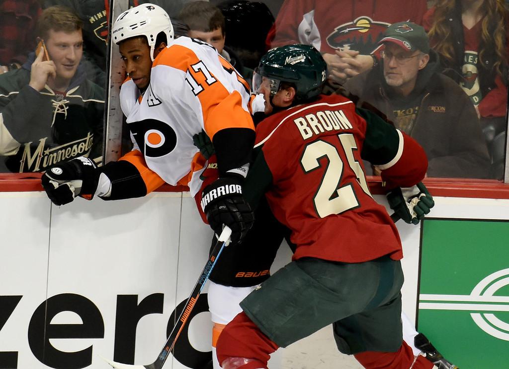 . Minnesota Wild defenseman Jonas Brodin checks Philadelphia Flyers right wing Wayne Simmonds into the glass in the first period at Xcel Energy Center on Thursday, January 7, 2015. (Pioneer Press: John Autey)