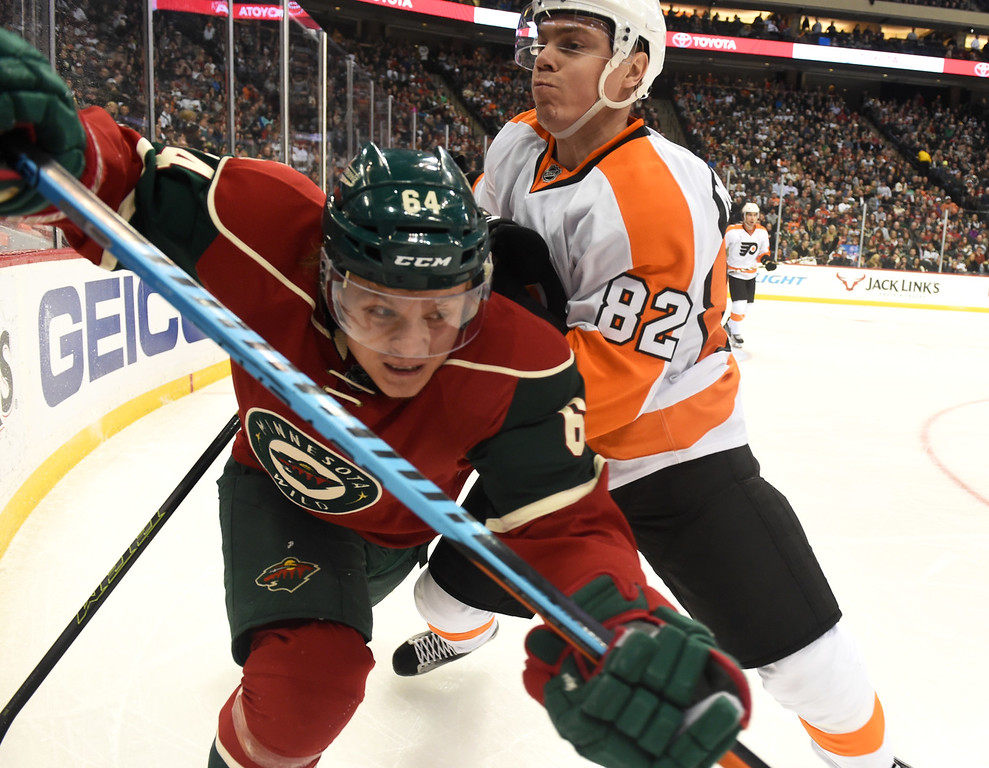 . Philadelphia Flyers defenseman Evgeny Medvedev tries to check Minnesota Wild center Mikael Granlund off the puck in the Philly zone in the second period at Xcel Energy Center on Thursday, January 7, 2015. (Pioneer Press: John Autey)