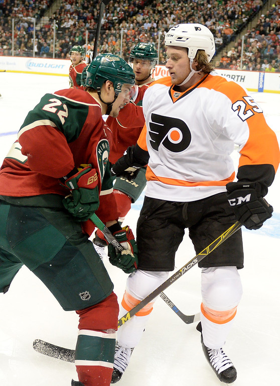 . Minnesota Wild right wing Nino Niederreiter picks up a two minute minor for th slash to Philadelphia Flyers center Ryan White in the third period at Xcel Energy Center on Thursday, January 7, 2015. The Philadelphia Flyers beat the Wild, 4-3, in overtime. (Pioneer Press: John Autey)