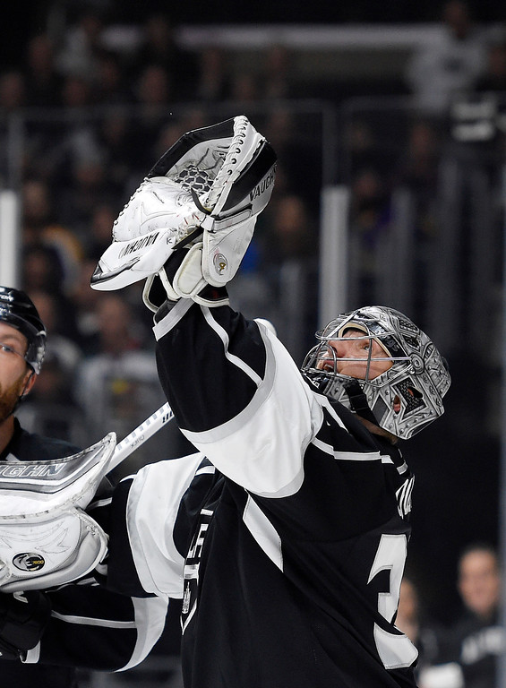 . Los Angeles Kings goalie Jonathan Quick catches the puck during the first period of the team\'s NHL hockey game against the Minnesota Wild, Thursday, Jan. 21, 2016, in Los Angeles. (AP Photo/Mark J. Terrill)