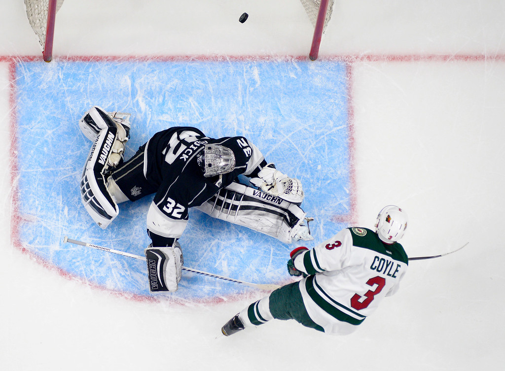 . Minnesota Wild center Charlie Coyle, right, scores on Los Angeles Kings goalie Jonathan Quick during the second period of an NHL hockey game Thursday, Jan. 21, 2016, in Los Angeles. (AP Photo/Mark J. Terrill)