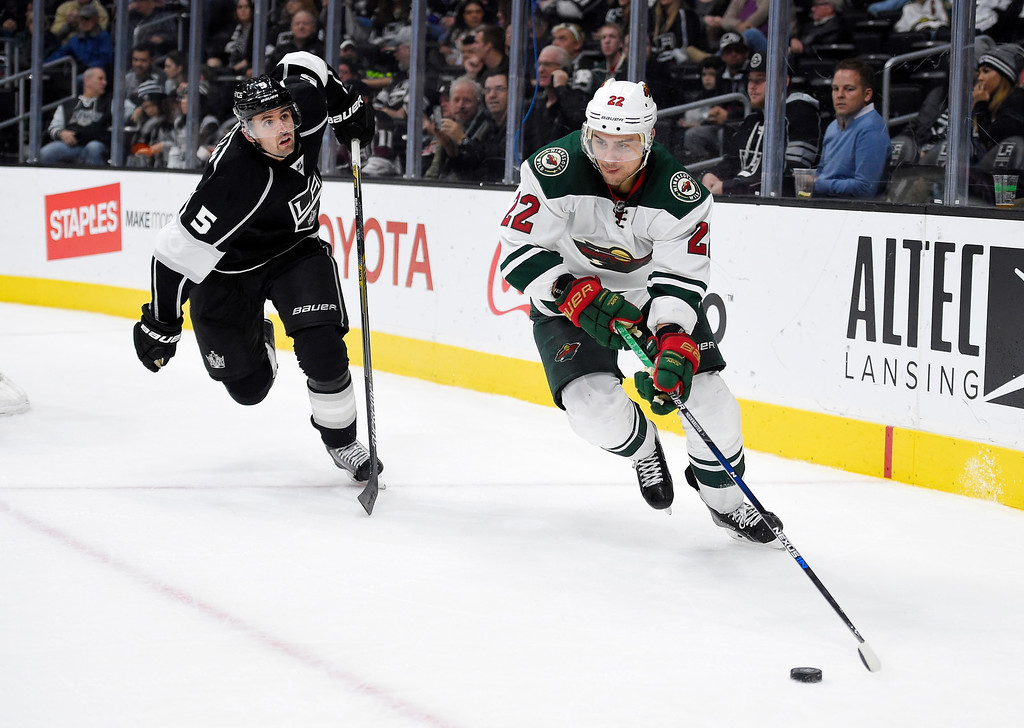 . Minnesota Wild right wing Nino Niederreiter, right, of Switzerland, moves the puck as Los Angeles Kings defenseman Jamie McBain skates behind during the third period of an NHL hockey game, Thursday, Jan. 21, 2016, in Los Angeles. The Wild won 3-0. (AP Photo/Mark J. Terrill)