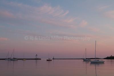 Cook County, MN, Grand Marais, Sunset on Sailboats and Pierhead Light
