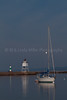 Cook County, MN, Grand Marais Sailboat in Front of Pierhead Light