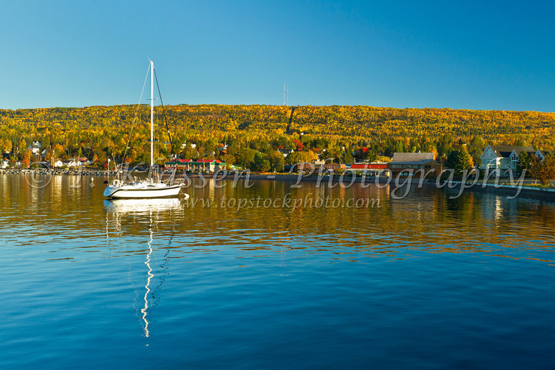 Boats and reflections in the bay at Grand Marais, Minnesota, USA.