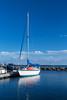 Sailboat reflections at the marina in Grand Marais, Minnesota, USA.