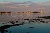 Lighthouse and harbor at sunset at Grand Marais, Minnesota, USA.