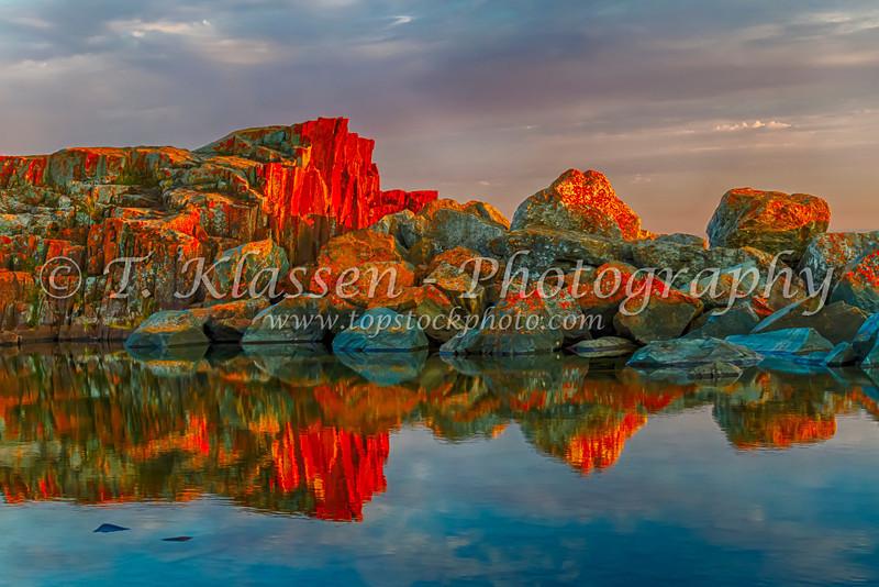 Rocks on the north shore of Lake Superior at sunset near Grand Marais, Minnesota, USA.