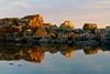 Rock formations at sunset reflected in Lake Superior at Grand Marais, Minnesota, USA.