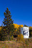 Fall foliage color and a welcome sign along the Gunflint Trail near Grand Marais, Minnesota, USA.