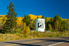 Fall foliage color and a welcome sign along the Gunflint Trail near Grand Marais, Minnesota, USA.