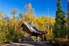 A smalll cottage and fall foliage color along the Gunflint Trail near Grand Marais, Minnesota, USA.