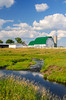 A dairy barn and small stream near Wadena, Minnesota, USA.