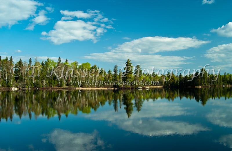 A calm small lake in northern Minnesota, USA, America.