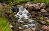 A decorative waterfall at the Minnesota Landscape Arboretum in Chaska, Minnesota, USA, America.