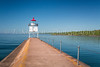 The breakwater and lighthouse in Agate Bay at Two Harbors, Minnesota, USA.