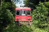 2) 540 058 in woods near Nassenwil on old line between Niederglatt and Otelfingen on 19th June 2006 working railtour