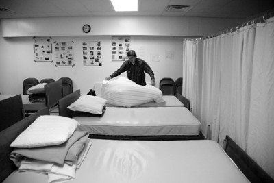 Minor James Miller Junior makes his bed at the PADS shelter in Mattoon, Illnois on December 29, 2009.  The shelter offers three meals a day and a bed to spend the night in to any one who needs it.   (Jay Grabiec)