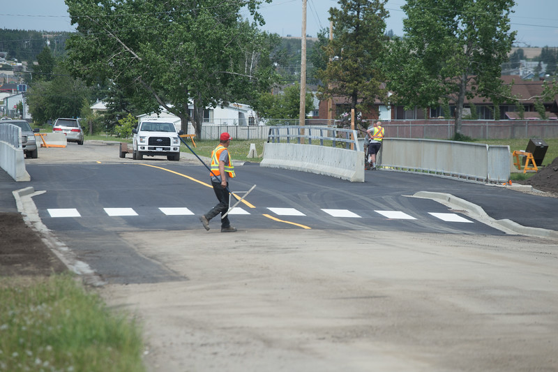 Workers put the finishing touches on the 15th Street Bridge.