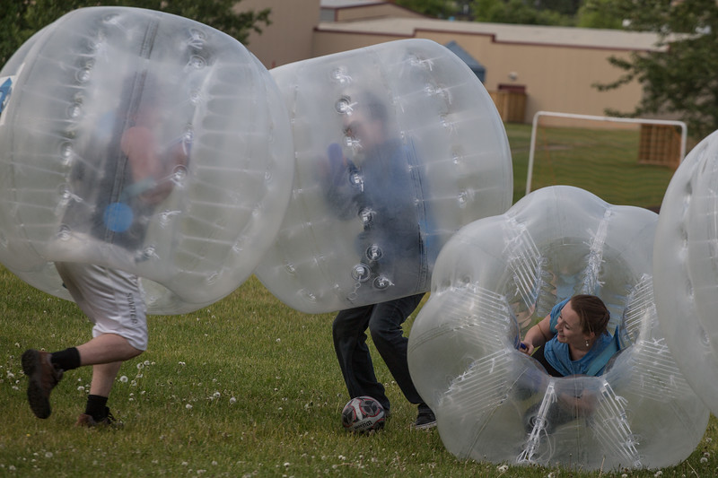 Emily is knocked to the ground during a game of bubble ball soccer in Tumbler Ridge.