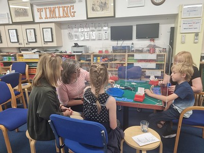 picture of young school children playing bridge