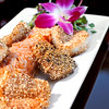 Pink peppercorn-encrusted diver sea scallops over watermelon sticky rice  <b>Back Nine Grill</b> East Ave, Pittsford