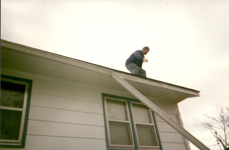 Steve on the roof again helping Stan repair tornado damage