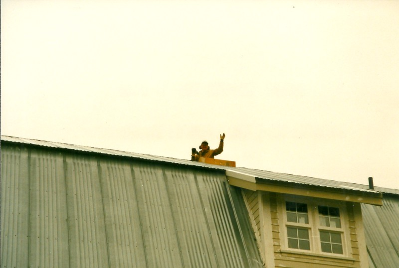 Steve on the roof to repair a leak ... 40-foot ladder required