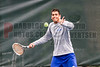 04/18/2014 - Altamonte Springs, Florida - Barron Collier High Schools Paul Johnson returns a server early in his State Title Overall Doubles match the in FHSAA 3A State Tennis Tournament.