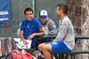 04/18/2014 - Altamonte Springs, Florida - Barron Collier Tennis Team Members Allen Sweet and Paul Johnson enjoy a break due to a small moisture delay early in the day Friday during the FHSAA 3A State Tennis Tournament.. Coach Michael Raymond in the background keeps an eye on the weather radar on his smartphone.