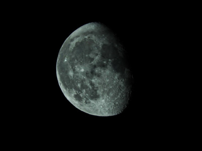 Hand held head out of the tent shot of the moon